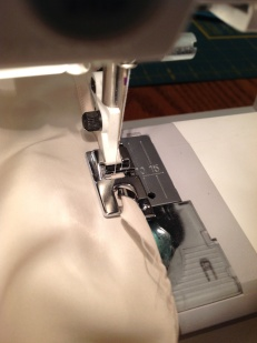 Hemming the lining.